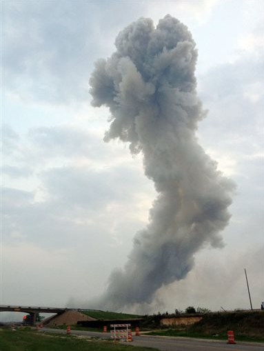 In this Wednesday, April 17, 2013, photo provided by Joe Berti, a plume of smoke rises from a fertilizer plant fire near Waco, Texas.