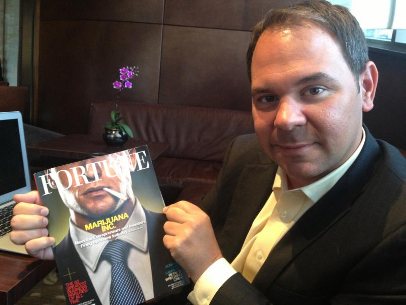 ArcView CEO Troy Dayton showing a recent Fortune magazine cover story on his group and the world of marijuana investing