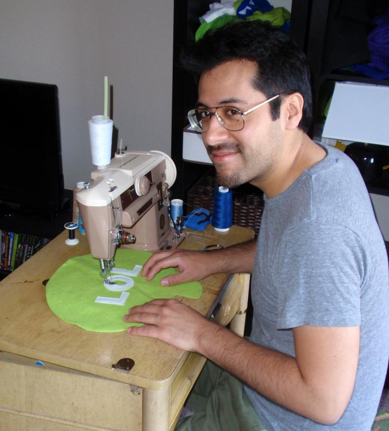Throwboy founder Roberto Hoyos is seen at work on his sewing machine.