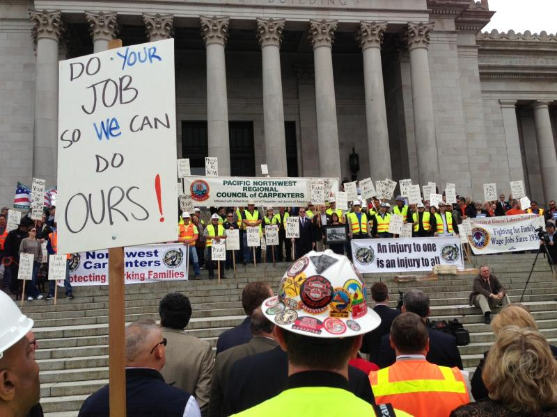Construction workers and others rally at the Washington Capitol in support of a gas tax measure to fund road projects.