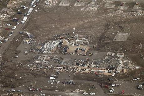 This aerial photo shows damage to Plaza Towers Elementary School after it was hit by a massive tornado in Moore, Okla., Monday May 20, 2013.
