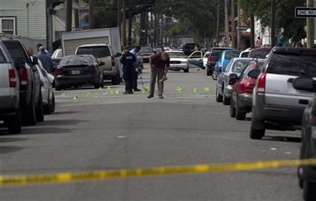 New Orleans Police investigate shooting at the intersection Frenchman Street at N. Villere on Mother's Day in New Orleans, Sunday May 12, 2013