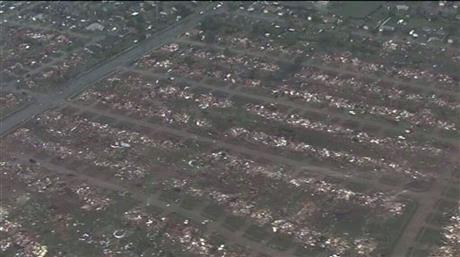 This photo provided by KFOR-TV shows homes flattened outside Moore, Okla., Monday, May 20, 2013.