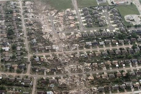This aerial photo shows the remains of homes hit by a massive tornado in Moore, Okla., Monday May 20, 2013.