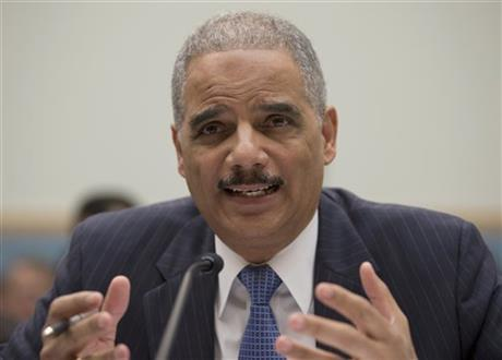 FILE - In this May 15, 2013, file photo, Attorney General Eric Holder gestures while testifying on Capitol Hill in Washington