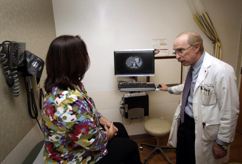 Dr. Paul J. Pockros, head, Division of Gastroenterology/ Hepatology and director, Liver Disease Center, talks with patient Loretta Roberts as they view her liver on a computer screen in his exam room at Scripps Green Hospital in San Diego, in this photo t