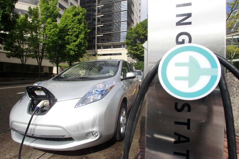 In this photo taken May 26, 2011, show a Nissan Leaf charging in Portland, Ore.