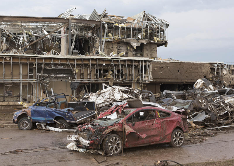 The Moore Medical Center and vehicles lay damaged after a tornado moves through Moore, Okla. on Monday, May 20, 2013.
