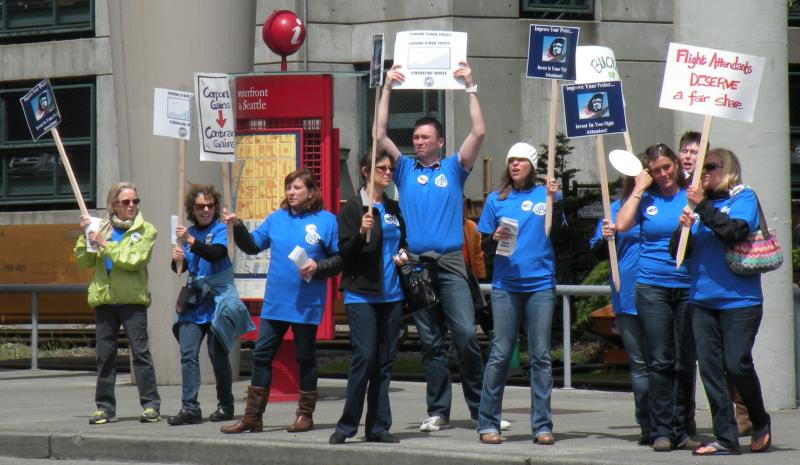 Alaska Air workers are seen protesting outside the annual shareholders meeting.