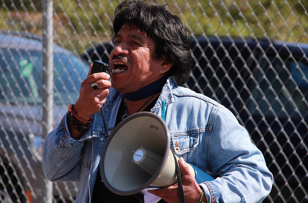 A speaker is seen addressing the crowd at Judkins Park.