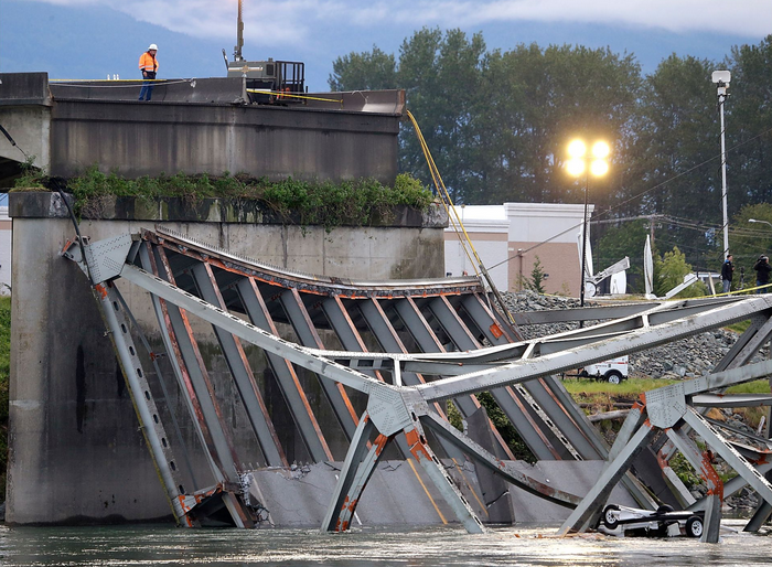An Interstate 5 bridge over a Skagit river collapsed north of Seattle Thursday evening May 23, 2013, dumping two vehicles into the water and sparking a rescue effort by boats and divers as three injured people were pulled from the chilly waterway.