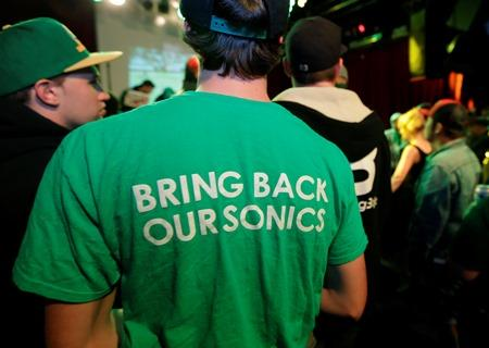 "A fan wears a shirt that reads ""Bring Back Our Sonics,"" as he attends a fan rally Monday in Seattle."