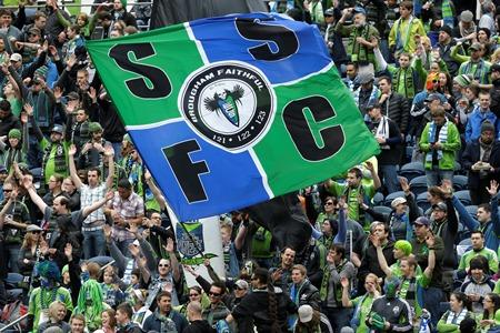 Sounders supporters wave a giant flag before a match in Seattle last month.