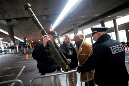 Officers examine an inert surface to air missile launcher brought to the gun buy back program run by the Seattle Police Department on Saturday.