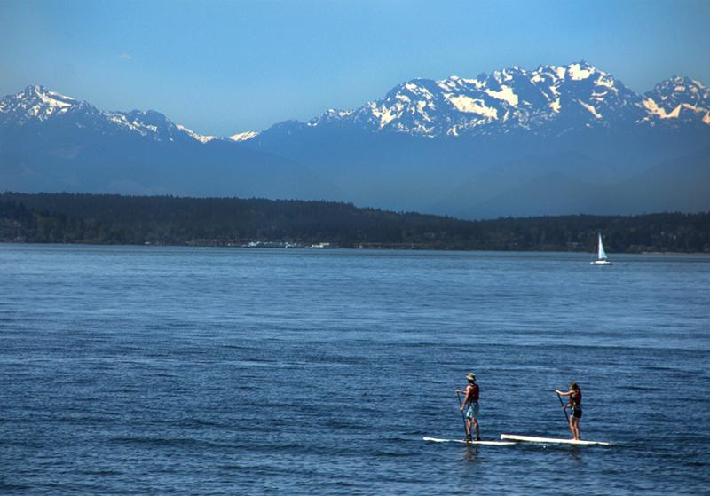 Two people are seen on paddleboards on Monday, March 6, 2013.