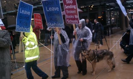 Blind protesters marching outside Amazon's headquarters in December