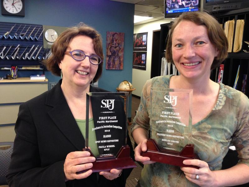 KPLU Law and Justice Reporter Paula Wissel, left, and KPLU Business and Labor Reporter Ashley Gross are seen with their first-place awards.