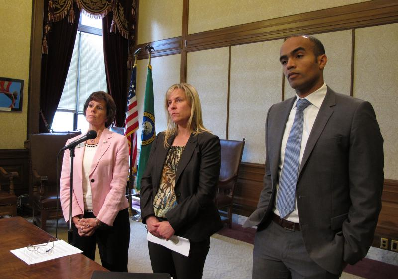 From left to right, Washington Gov. Jay Inslee's Chief of Staff Mary Alice Heuschel, Julie Murray from the Office of Financial Management, and Inslee's general counsel, Nicholas Brown, listen to a question from the media about contingency plans for a pote