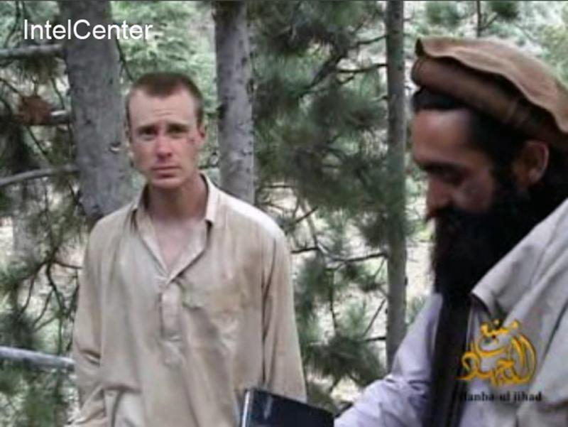 FILE - This file image provided by IntelCenter on Wednesday Dec. 8, 2010 shows a frame grab from a video released by the Taliban containing footage of a man believed to be Bowe Bergdahl, left.