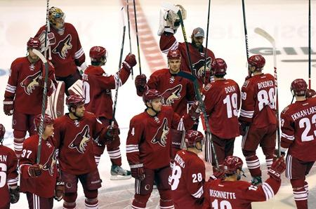 The Phoenix Coyotes take the ice to greet fans prior to an NHL hockey game against the Chicago Blackhawks earlier this season in Glendale, Ariz.