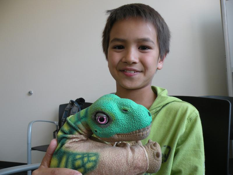 Marcus likes his robo-pal Pleo, but wouldn't trade in his leopard gecko.