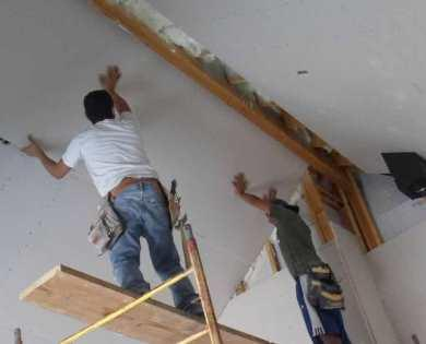Even drywall workers paid a piece rate are subject to minimum wage rules, according to the Labor Dept.