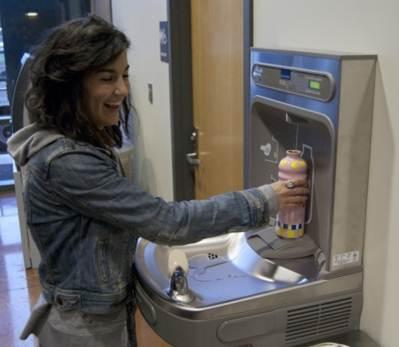 Anna Amundson, a WWU alumnae and past president of Students for Sustainable Water  fills up at one of three grant-funded hydration stations students have spearheaded to replace use of water in disposable plastic bottles.