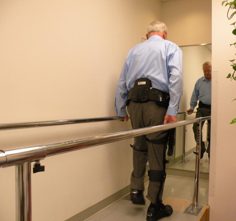 """Carl Simmons of Lynnwood tries out his new """"Kickstart"""" walking device."""