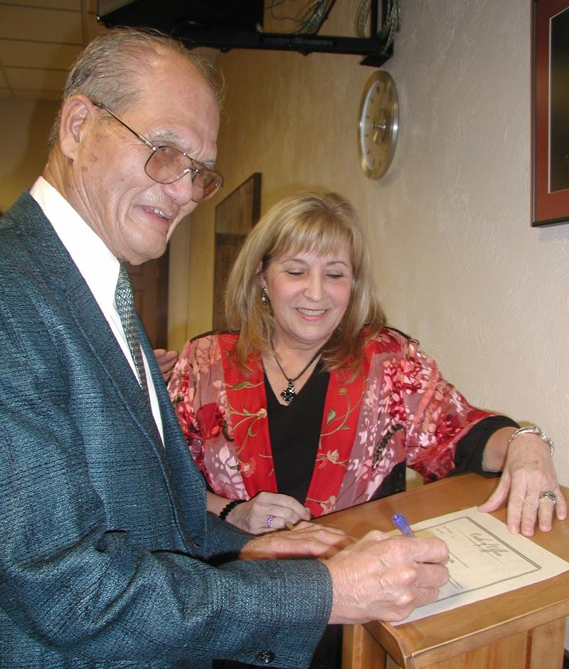 Pacific Mayor Cy Sun, left, is seen signing his oath of office with Pacific City Clerk Jane Montgomery.
