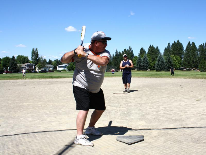 Loren Miller takes a few practice swings before coach Troy Leeberg starts the pitch. They're members of the Spokane Pride Beep Baseball team.