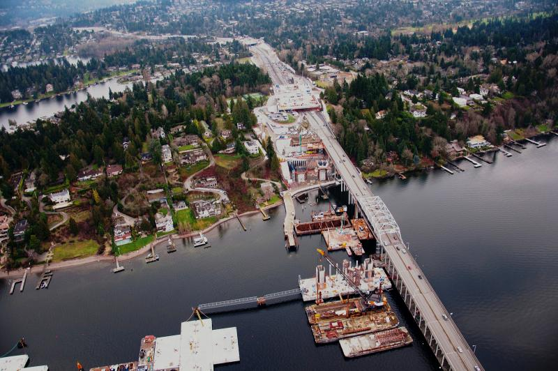 Viewed from above Medina, Washington, the new SR 520 floating bridge takes shape next to the current bridge.