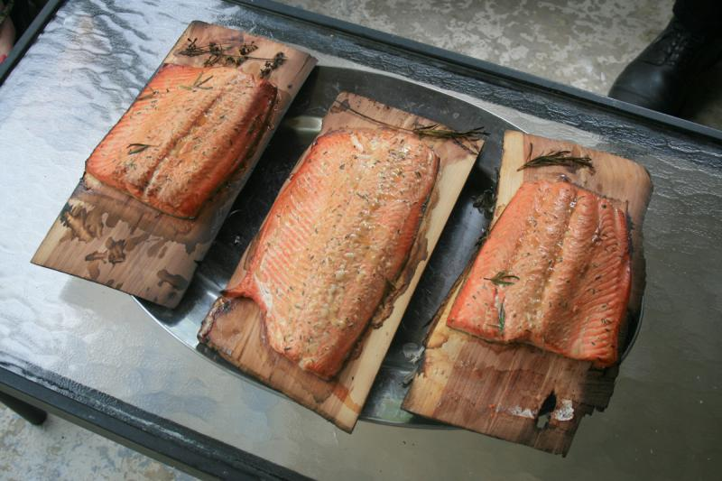 How much fish is safe to eat? Only one small filet per month under Washington's current water quality standard - a fraction of what's shown in this picture of a traditional NW meal of wild salmon on cedar planks.