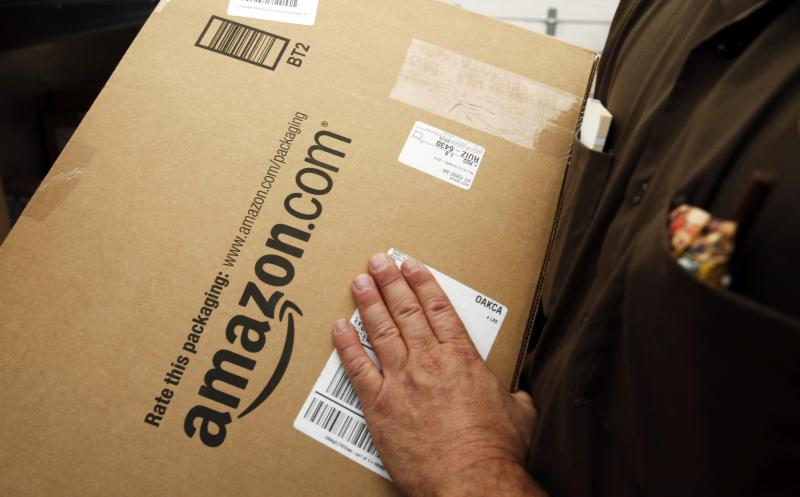 FILE - In this Oct. 18, 2010 file photo, an Amazon.com package is prepared for shipment by a United Parcel Service driver in Palo Alto, Calif.