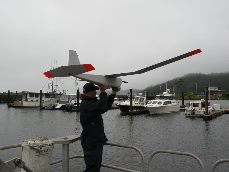 The Puma AE unmanned aircraft system, shown during a pre-flight check for tests in NOAA's marine research missions from La Push, on the Olympic Penninsula. It launches without a runway, making it ideal for NOAA's missions at sea, the agency says.