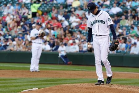 Mariners starting pitcher Hisashi Iwakuma stands on the mound in Tuesday's game against the Boston Red Sox at Safeco Field. Iwakuma gave up five runs in the inning.