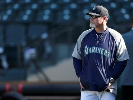 Mariners manager Eric Wedge watches batting practice before a baseball game against the Houston Astros, Wed., June 12, 2013, in Seattle.