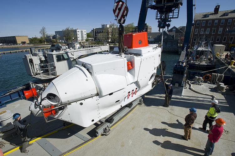 Upgraded minisub Alvin was loaded onto R/V Atlantis at the WHOI dock on May 13, 2013.