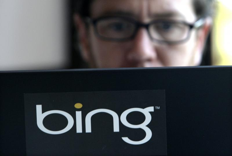 FILE - Vendor Patrick Porter works on a laptop marked with the logo for Bing, Microsoft's recently upgraded search engine, in a cafeteria at Microsoft in Redmond, Wash., Wednesday, July 29, 2009.