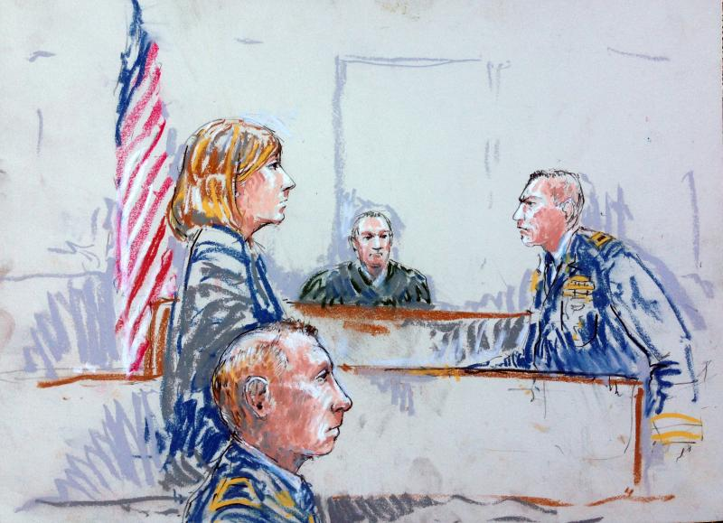 In this courtroom sketch, Staff Sgt. Robert Bales, foreground, is seated in a courtroom at Joint Base Lewis-McChord, Wash. on Tuesday, Aug. 20, 2013, during a sentencing hearing in the slayings of 16 civilians killed during pre-dawn raids on two villages