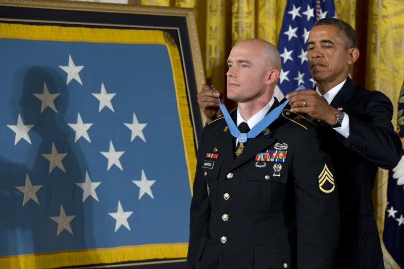 President Barack Obama awards U.S. Army Staff Sgt. Ty M. Carter the Medal of Honor for conspicuous gallantry, Monday, Aug. 26, 2013, during a ceremony in the East Room of the White House in Washington.