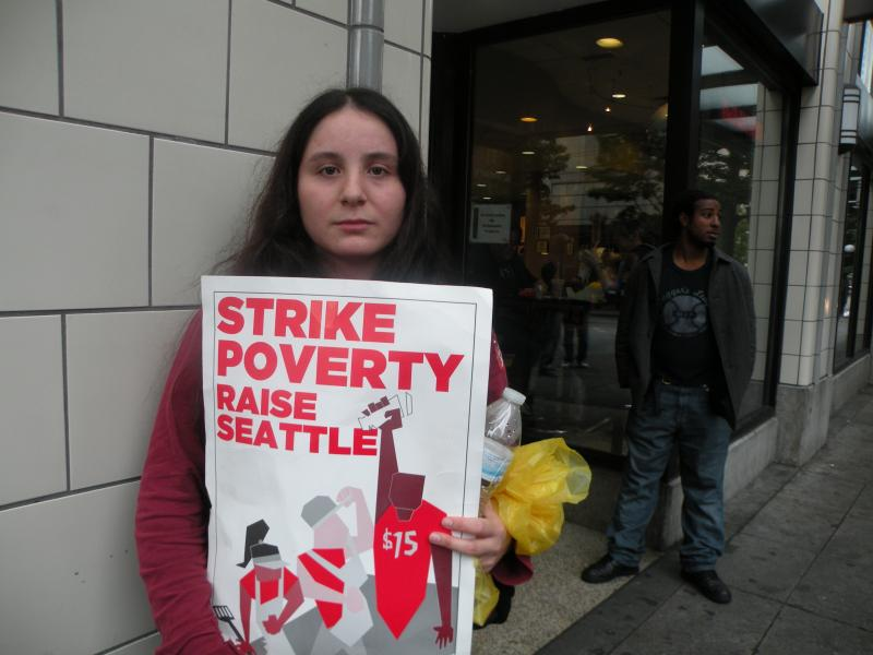 Cristina Rodriguez works at a Subway locationl in downtown Seattle. She skipped work to participate in the protest, even though she says her boss threatened to fire her if she skipped work.