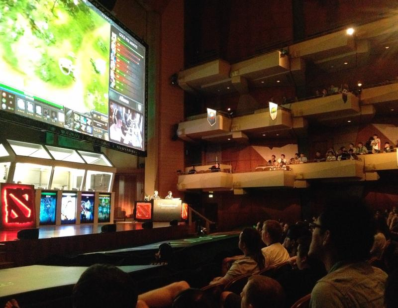 A sold-out crowd of gamers watch an early round of The International Dota 2 Championship
