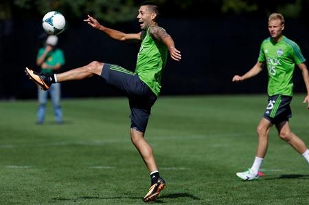 Clint Dempsey, left, the newest member of the Seattle Sounders, trains for the first time with the team, Wed., Aug. 7, in Tukwila. The Sounders face Toronto FC on Saturday.