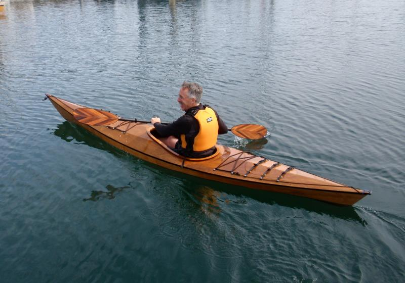 "Jim Hix of Portland test paddles Pygmy's bestselling ""Pinguino"" model at the Point Hudson marina in Port Townsend."