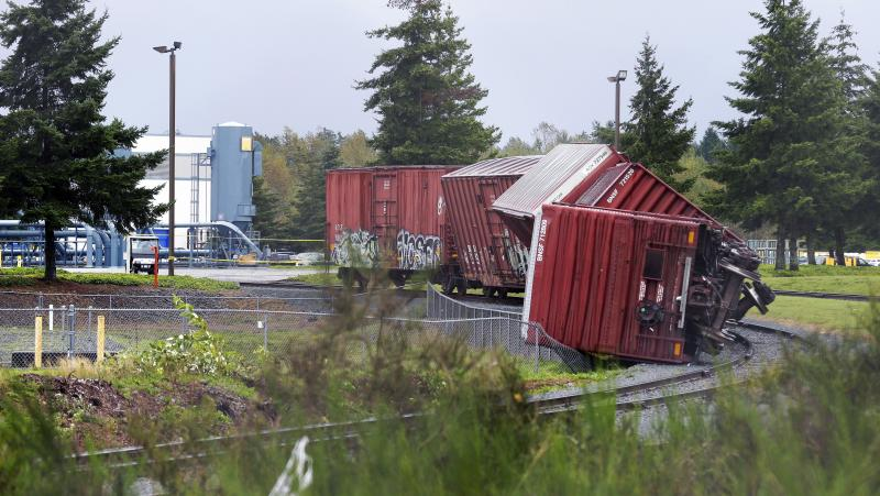 Rail cars are overturned near Boeing's Frederickson facility in Puyallup, Wash., Monday, Sept. 30, 2013 after a tornado came through the area earlier in the morning.