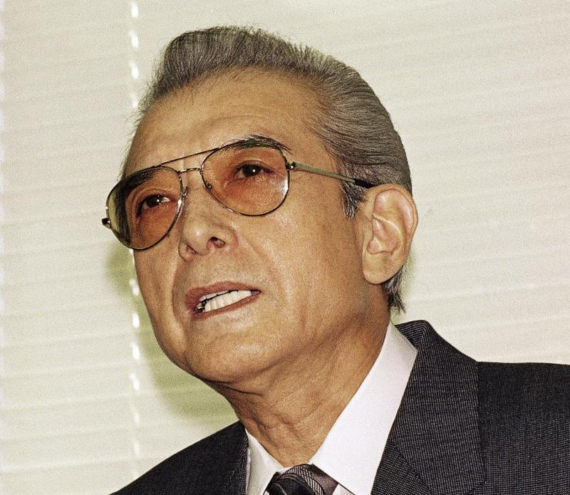 FILE - In this Friday, June 12, 1992 file photo, Hiroshi Yamauchi, then-president of Japan's Nintendo Co., answers questions during a news conference after he won the final approval to buy the Seattle Mariners at the company's head office in Kyoto.