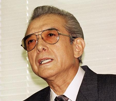 File photo: Hiroshi Yamauchi, then-president of Japan's Nintendo Co., answers questions during a news conference after he won the final approval to buy the Mariners in 1992.