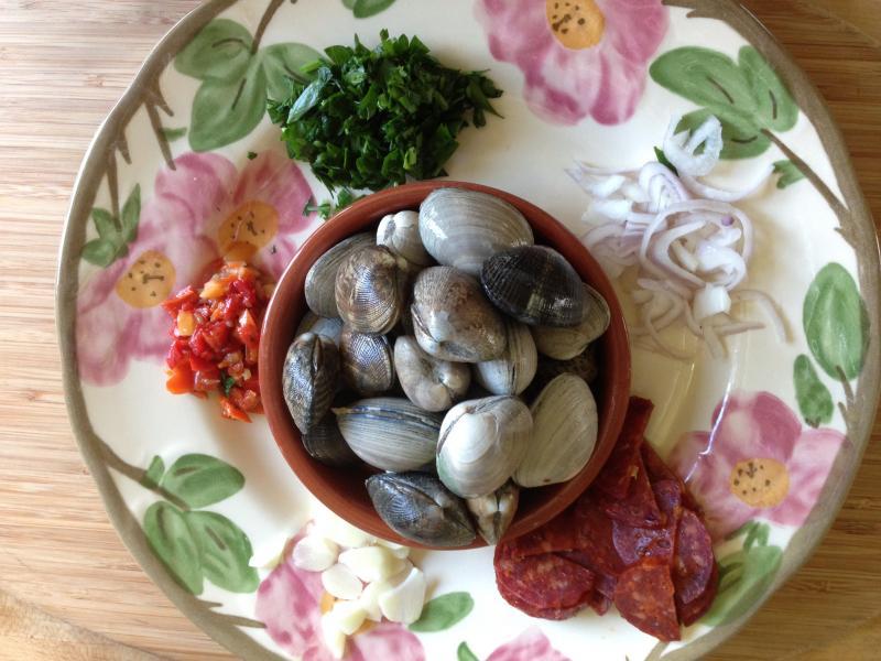 Before: Nancy arranges ingredients for Lark Restaurant's Manila clams.