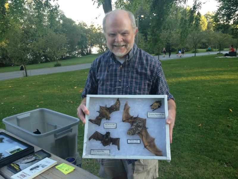 "John Bassett, a retired professor of biology from the University of Washington, admits he's like a walking encyclopedia of bat lore. ""It's an addiction,"" he says."