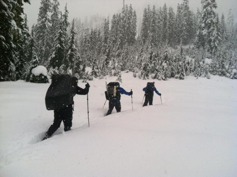 PCT thru-hikers struggling through several feet of snow on the trail earlier this week, north of Stevens Pass.